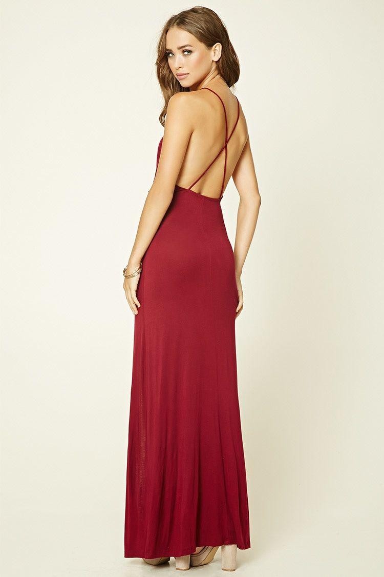 A knit maxi dress featuring a surplice front, V-neckline, crisscross spaghetti…
