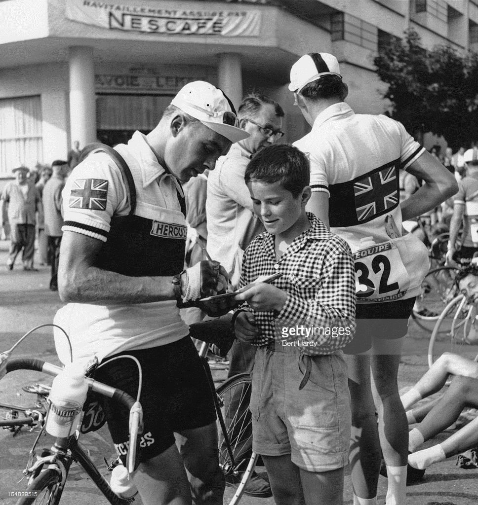 British cyclist Brian Robinson signs an autograph for a fan during the 9th stage of the Tour de France 1955