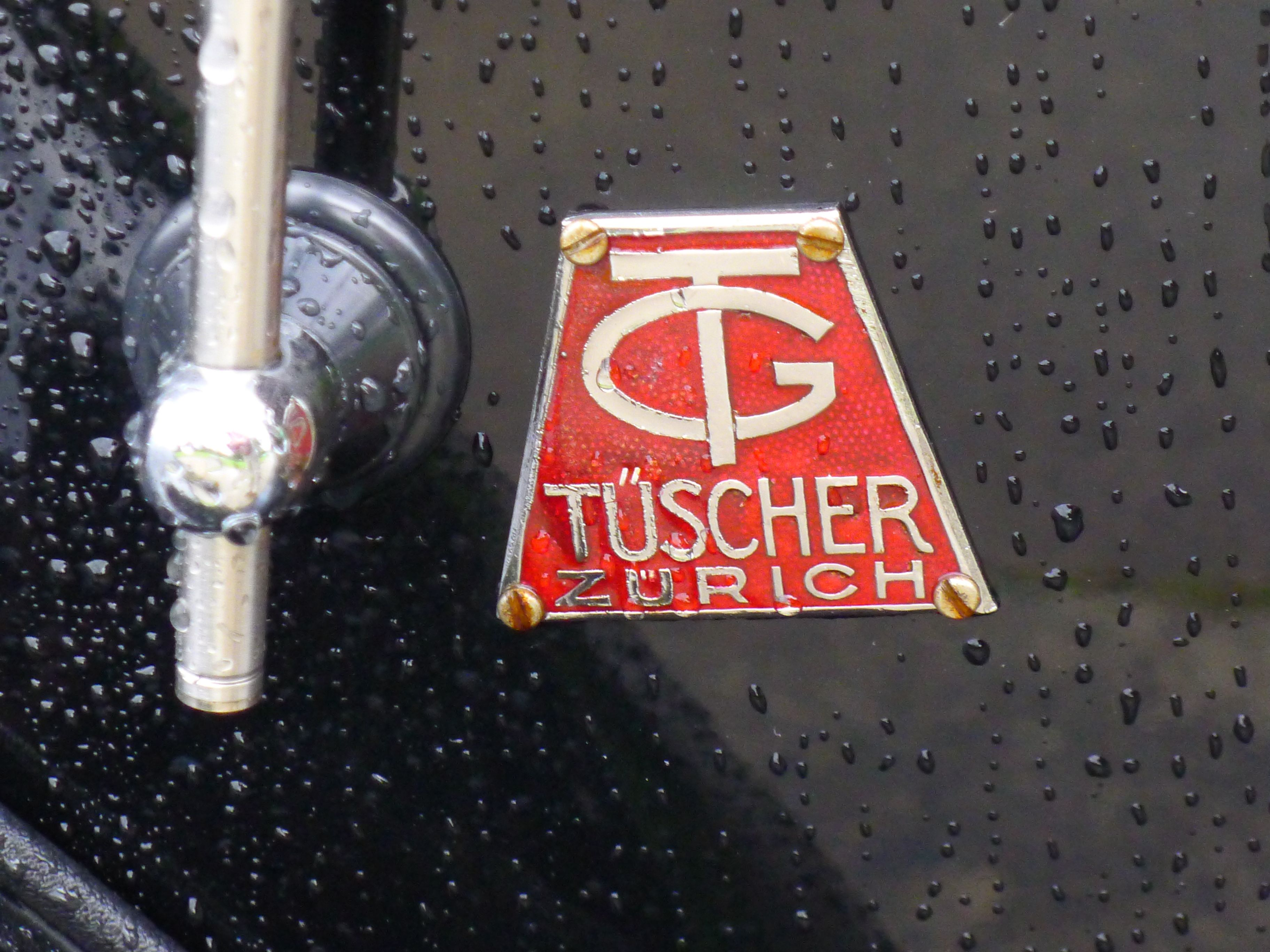 This is my 1937 Chrysler 6 DeLuxe , Coachbuild by Tüscher & Co. Zurich Chassis number 10171420 engine number P4*64337* The car was sold by dealer Epper in Luzern (Lucerne, Switzerland), Both companies, Epper and Tüscher are still in business. The engine is a 6cyl. 3299.3 cc (201,3 cid) . 82Hp (60.4 kW) @ 3600 RPM. Under the hood, on the left side you can still see the World War II confiscate number 203853.  More pictures on :  http://users.skynet.be/bruno.costers/chrysler/gespot.html