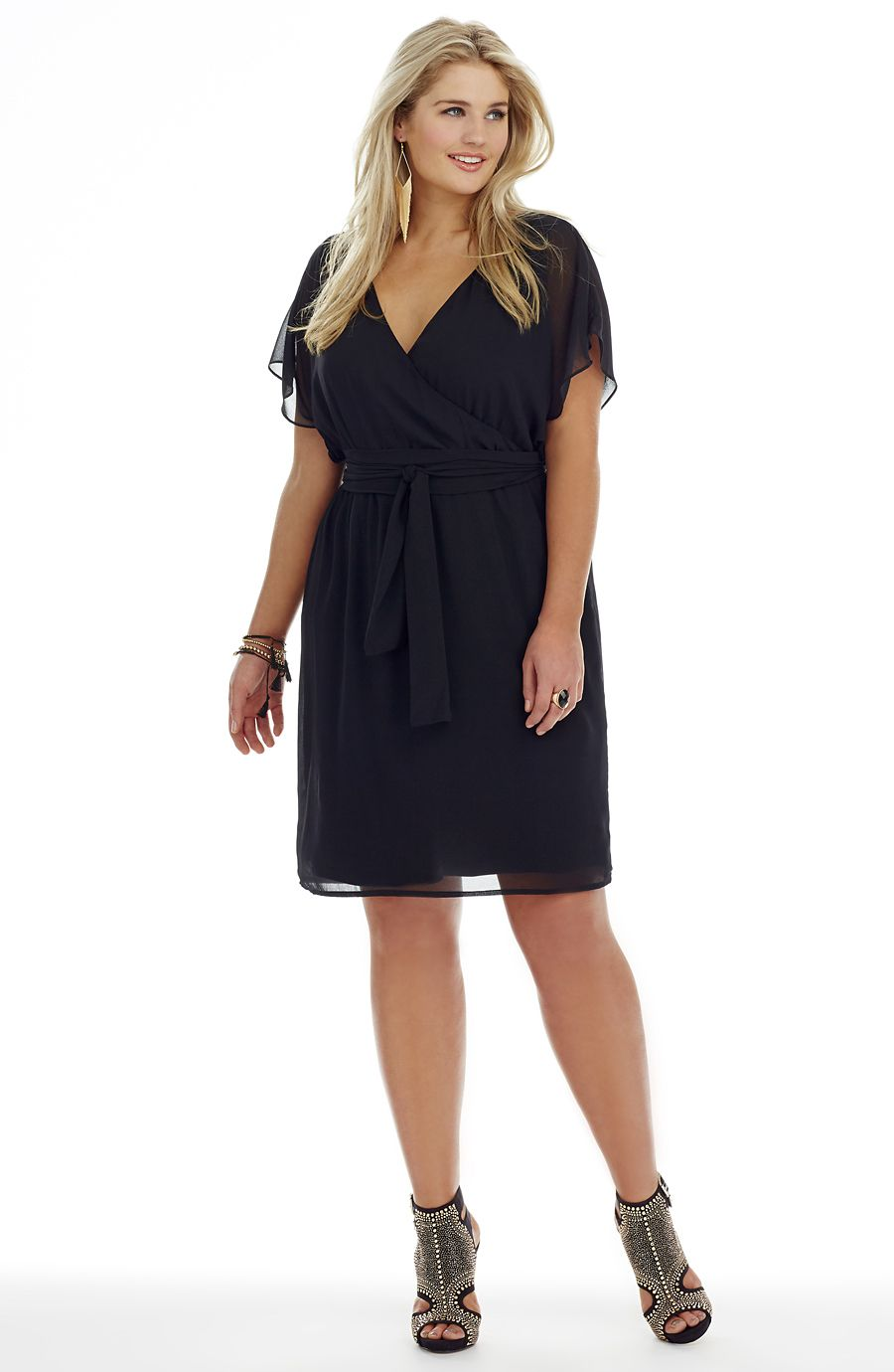 Georgette crossover dress. This dress can be worn two ways!  One side of the dress has a cross over front.  Switch it round and you have a dress with a keyhole front.  The dress has loose sheer sleeves and is elasticized at the waist.