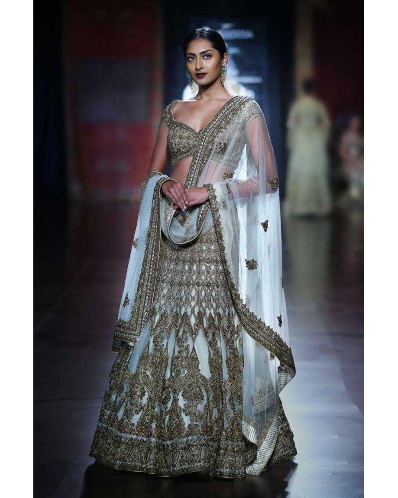 43b857b051 Beige Yellow silk embroidered lehenga choli intricate with zari thread,  resham threads,