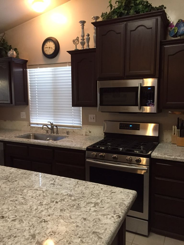 Qortstone Silver Cloud Quartz countertops. I still need to
