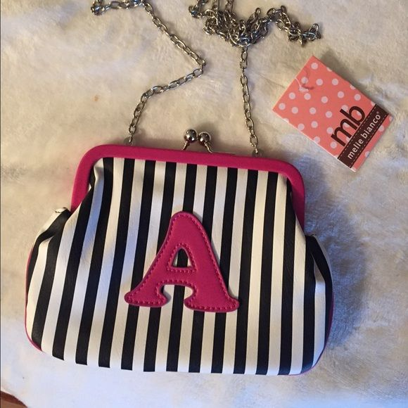 Brand new with tags cross body purse Melie. Bianca cute cross body with chain . Also from a smoke free home. With tags Melie Bianco Bags Crossbody Bags