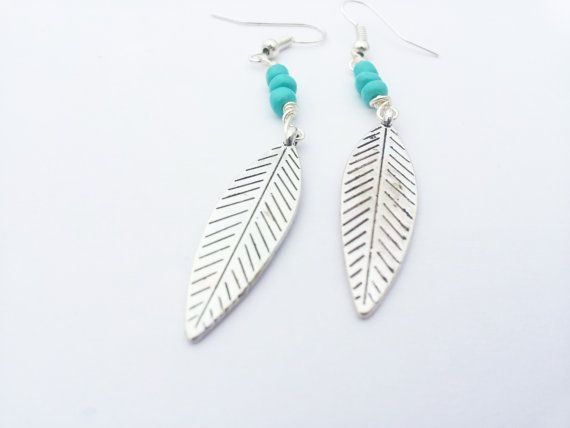 Check out this item in my Etsy shop https://www.etsy.com/listing/216525202/long-leaf-silver-leaf-turquoise-dangle