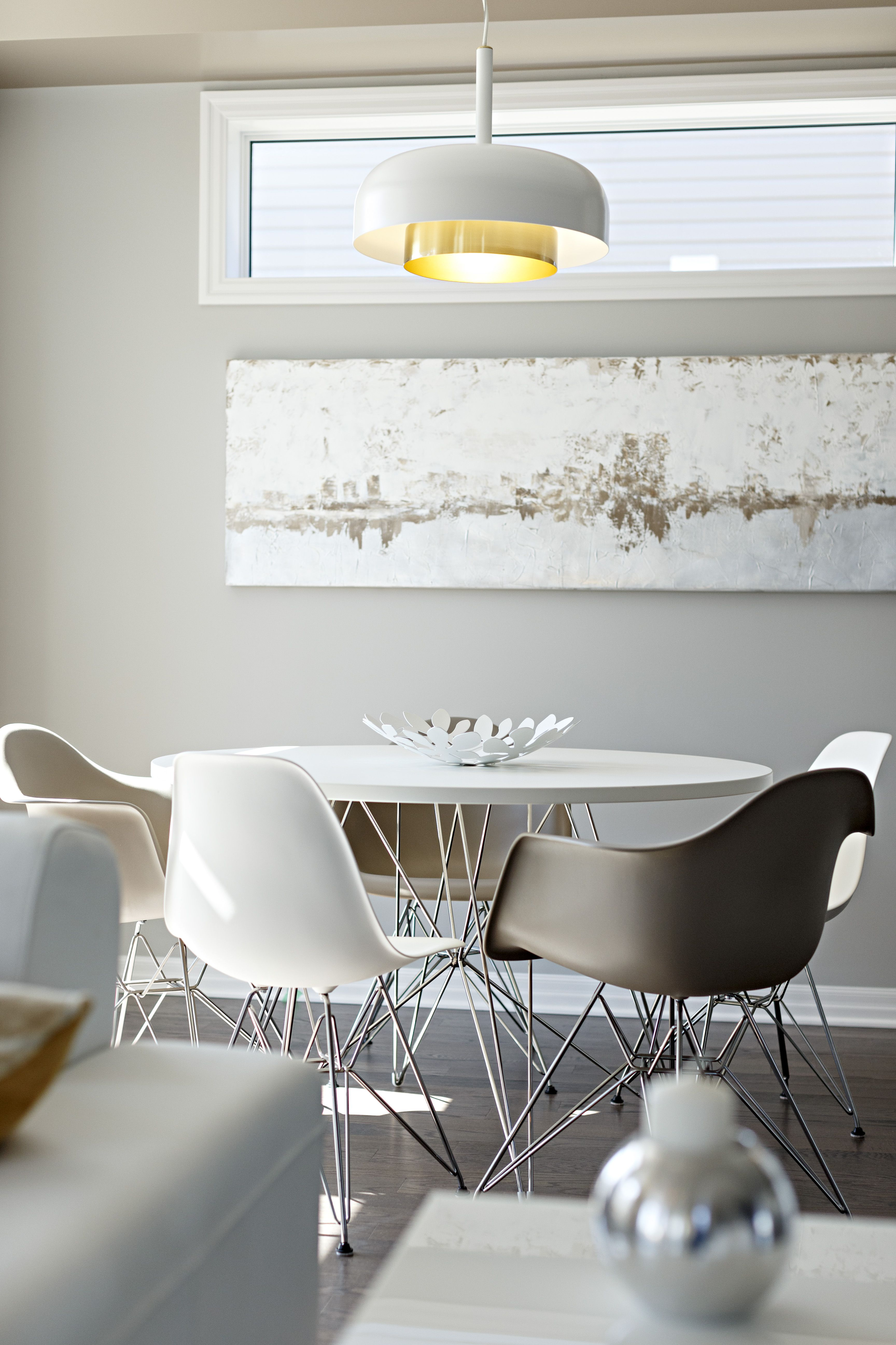 Eiffel Chairs Around The Dining Table In COLTON Model Home Located At Spring Valley Trails Navan Ontario