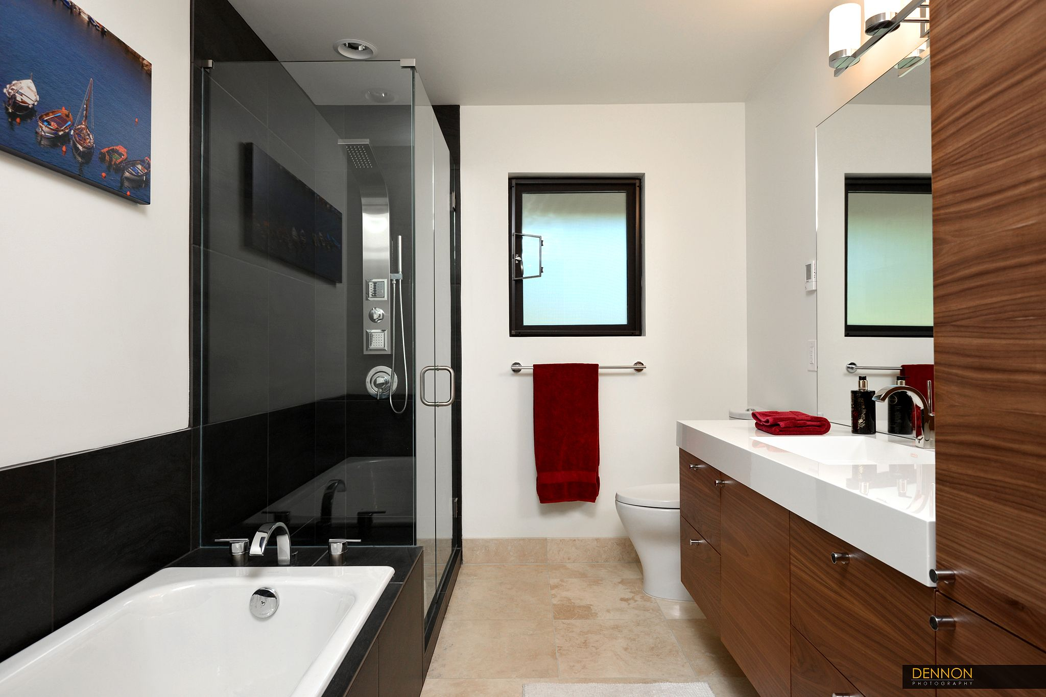 photos of remodeled bathrooms%0A The bathroom is newly remodeled with modern finishes  The black tile  contrasts with the modern