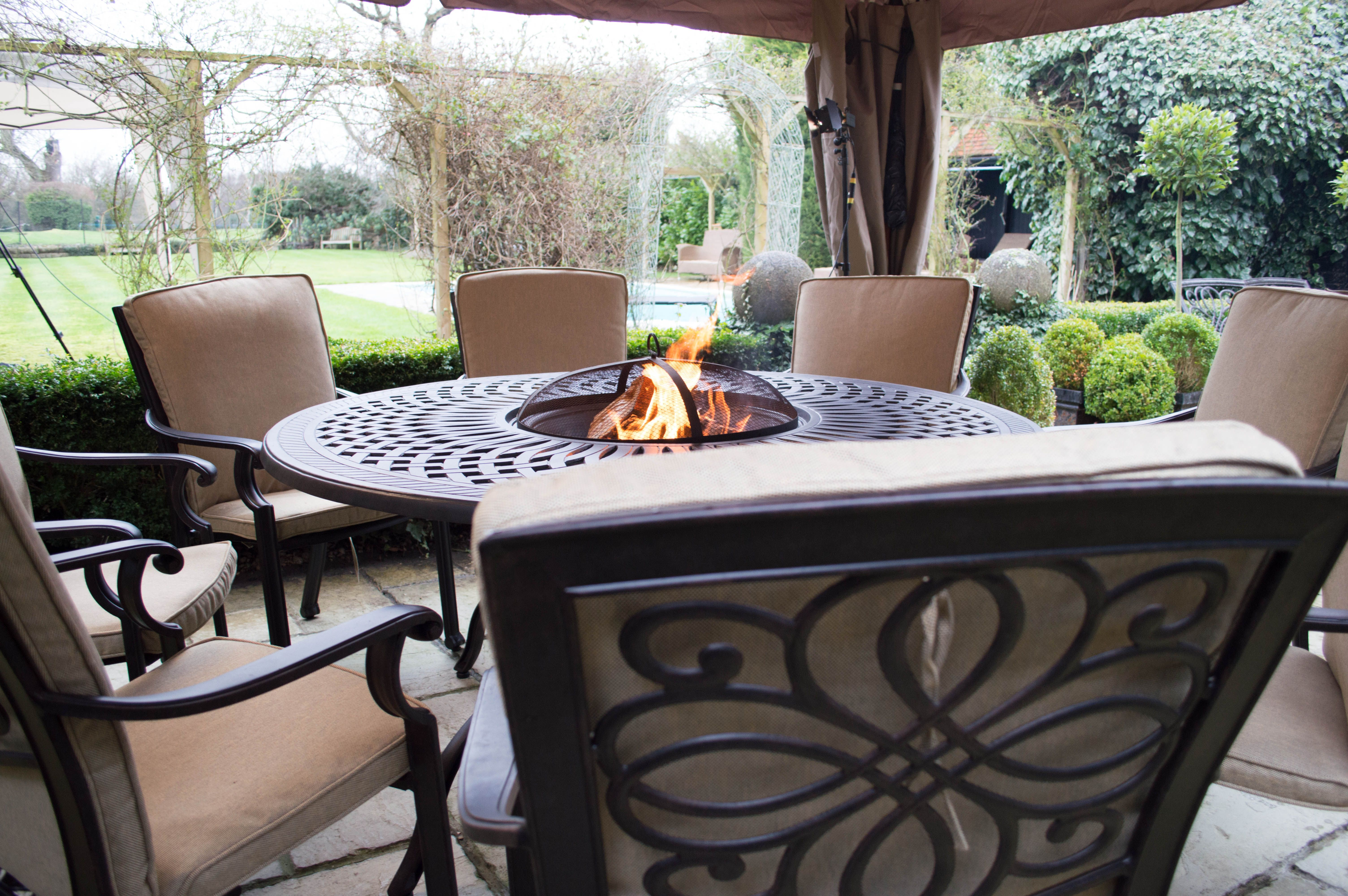 Garden Furniture With Fire Pit Uk great pic of a gregg wallace dining set under a gazebo http