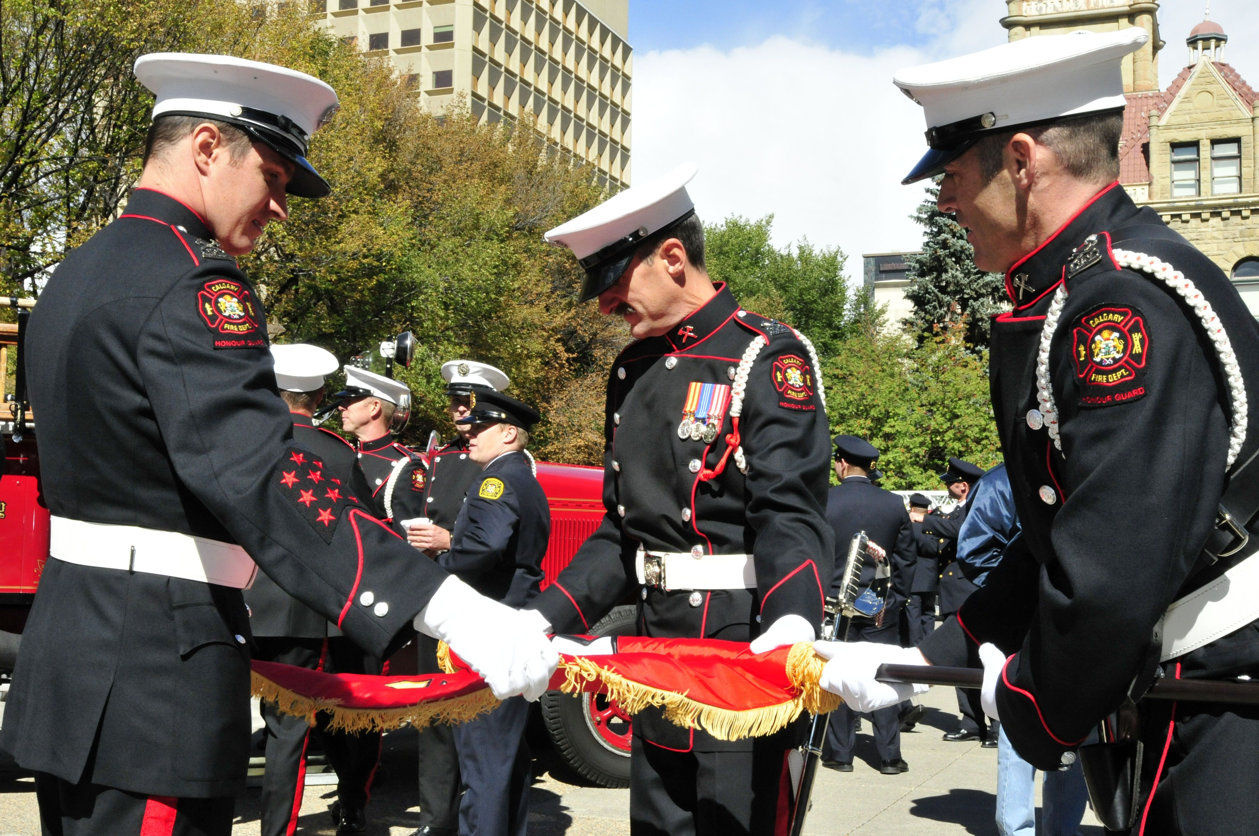 Calgary firefighters at the memorial of fallen firefighters