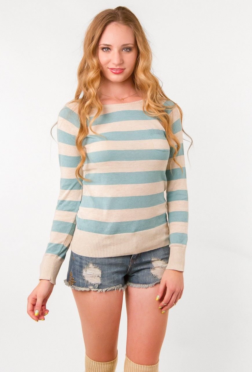 "The sophisticated horizontal thick stripes of cream and baby blue on this pull-over sweater reminds us of the sweet and innocent (and sometimes neurotic) Charlotte York, of Sex and the City. Pull any look together with this simple and clean long-sleeve. The fact that it's the color of the iconic ""blue box,"" that usually comes with something sparkly inside, makes us feel like Charlotte would have a closet full of these classic and versatile sweaters. Of course, any Charlotte should. Layer…"