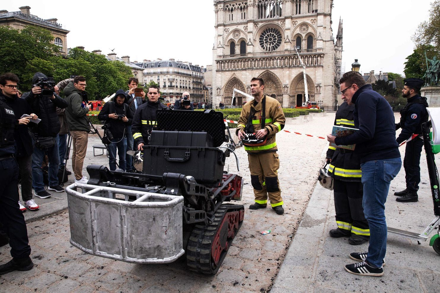 French Officials Say A Robot Named Colossus Played A Crucial Role In Saving The Notre Dame From Complete Destruction The Rob Firefighter Colossus Fire Brigade