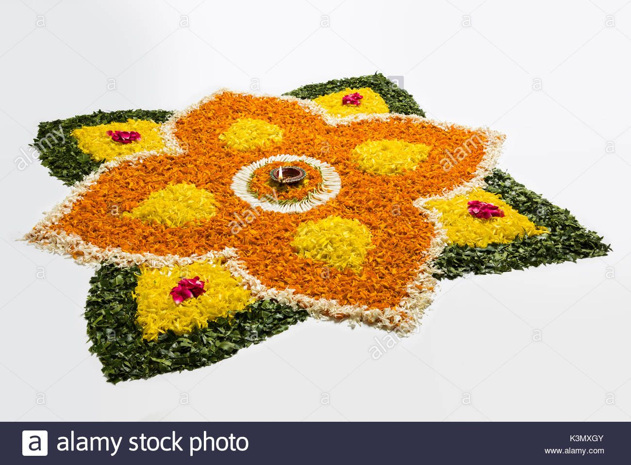 Download This Stock Image Flower Rangoli For Diwali Or Pongal Or Onam Made Using Marigold Or Zendu Flowers And Red Red Rose Petals Flower Rangoli Rose Petals