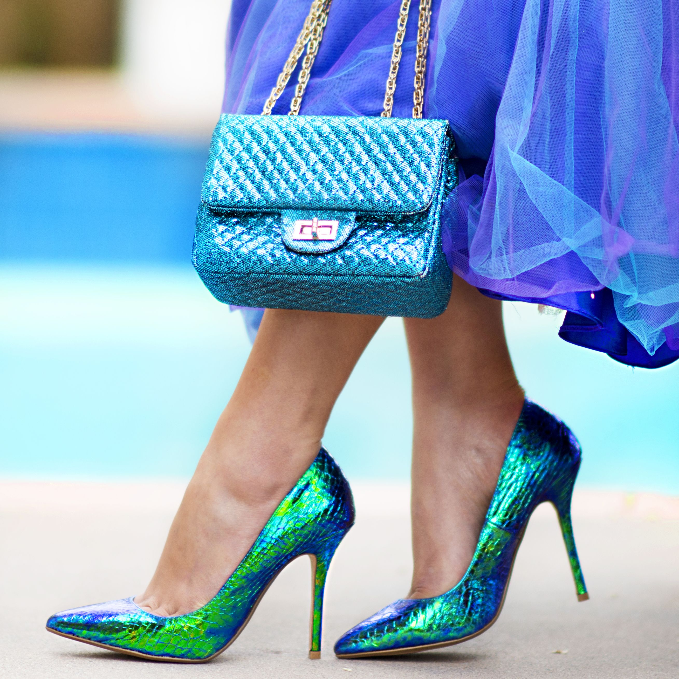 15a209344c9b Is this pair of iridescent blue metallic snake print high heel pump shoes  from Dune London and this blue metallic mini shoulder bag the perfect match  ...
