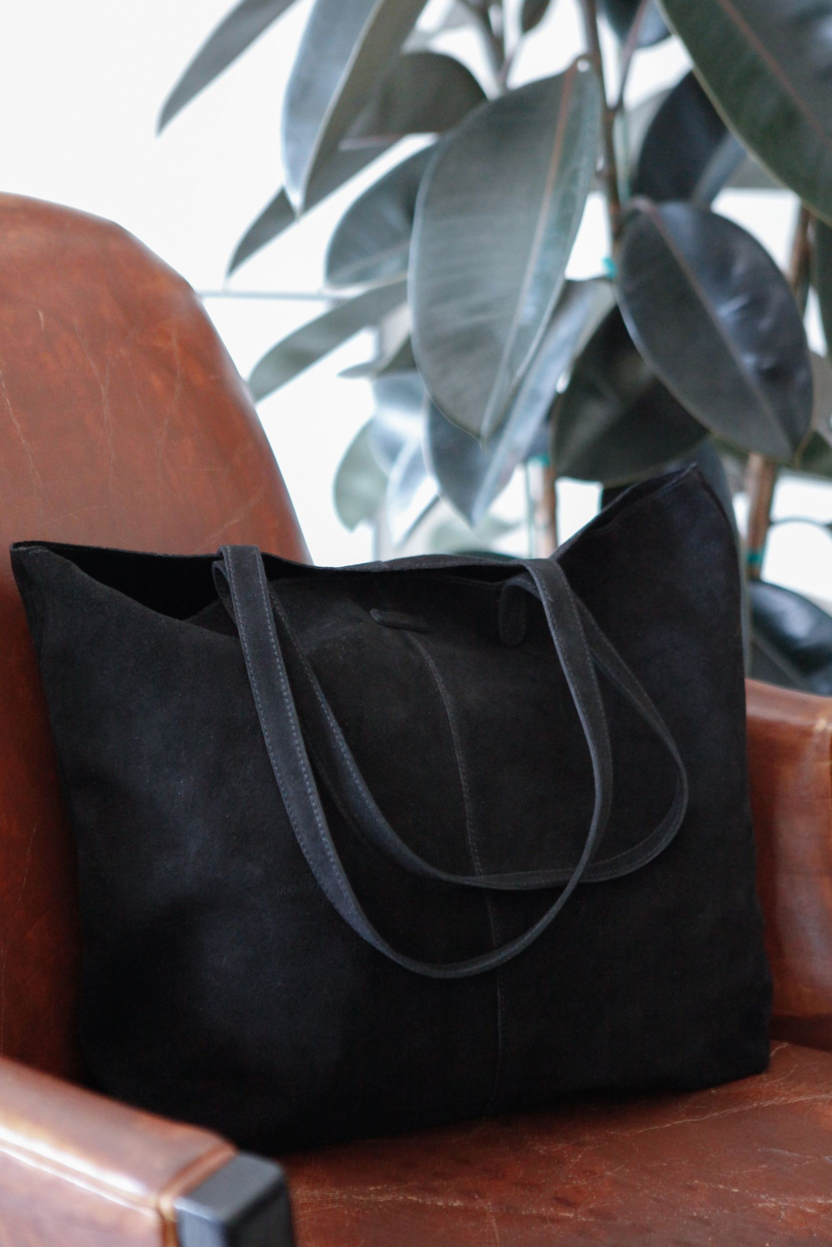450b6b2c481 Put everything you need in one place with a black suede TOMS Cosmopolitan  tote. Every bag you purchase helps provide a safe birth to a mother and  baby in ...