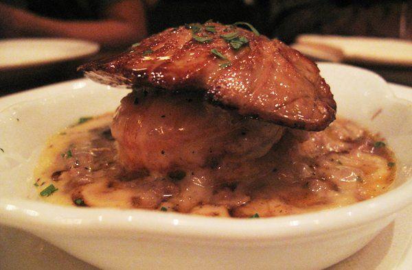 foie gras, biscuit and maple gravy.  @animal.