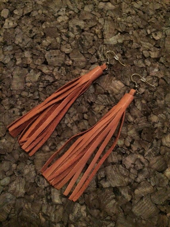 These are beautiful leather tassel earrings that come in tan leather and dark brown leather. They hang at 4.5 and are mounted on antique brass