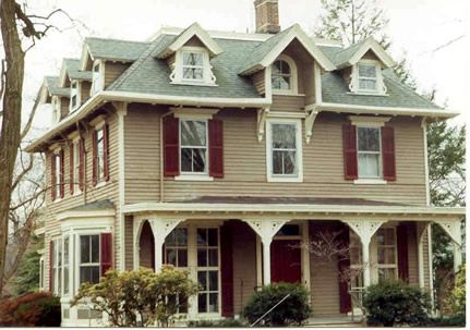 Tan House Cream Trim Maroon Shutters Wrap Around Porch House