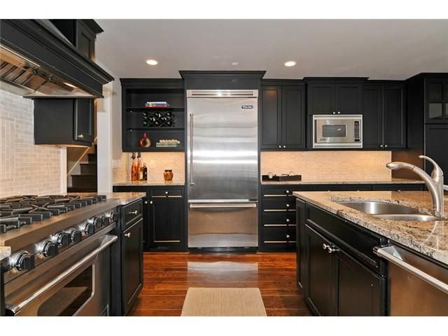 Spacious Kitchen With Island Eating Area Marble Counter Tops And