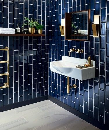 Modern fixtures. Blue tile. #industrialinteriordesign
