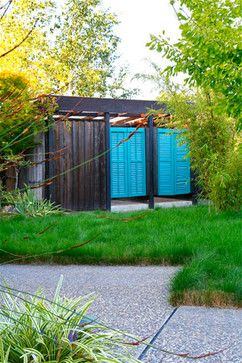 Greening the suburbs - The new louvered swinging doors on this 1960's rustic pool house added a jolt of color to the otherwise drab exterior. As a final touch, we added a no-mow fescue lawn. Photo- Chris Jacobson, GardenArt Group