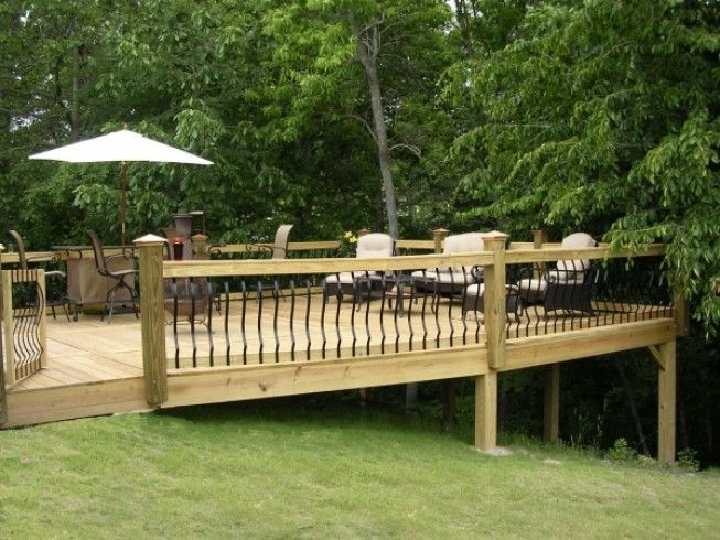 Deck built onto sloped yard railings landscaping steep for Small deck seating ideas