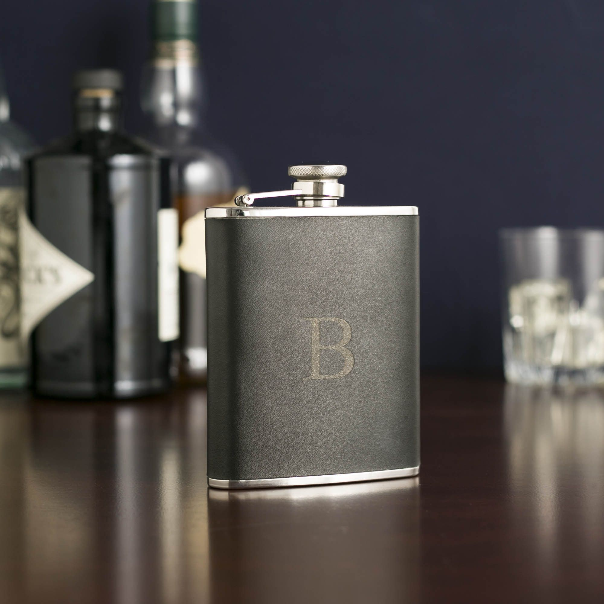 Leather Flask, Black | Clad in black leather and featuring an attached, rubber-sealed cap, this flask has efficiency and good looks.