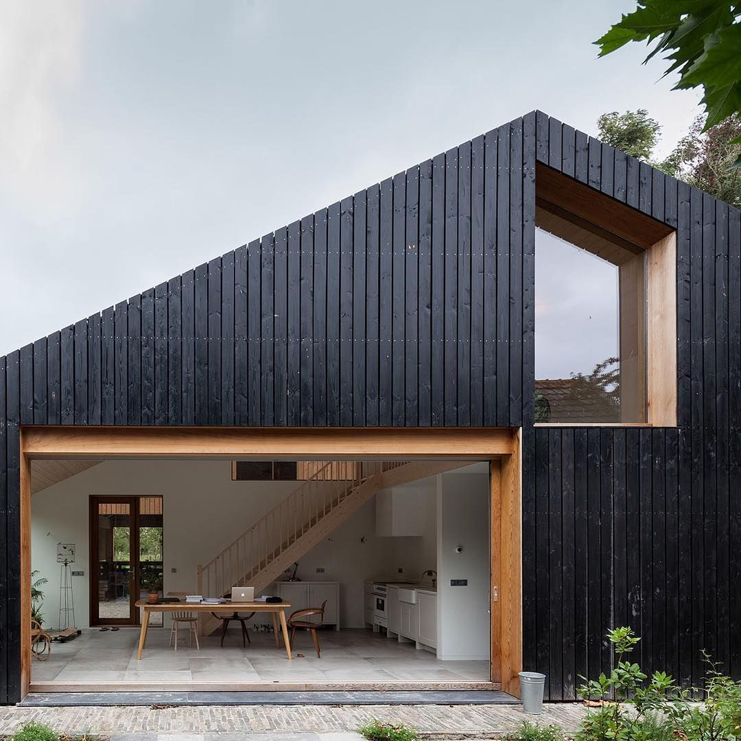 Workshop Architecten Has Created A Blackened Wood Barn For