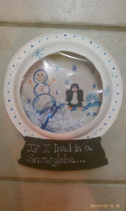 If I lived in a snow globe... two paper plates, a ziplock bag, hole punches and construction paper.3
