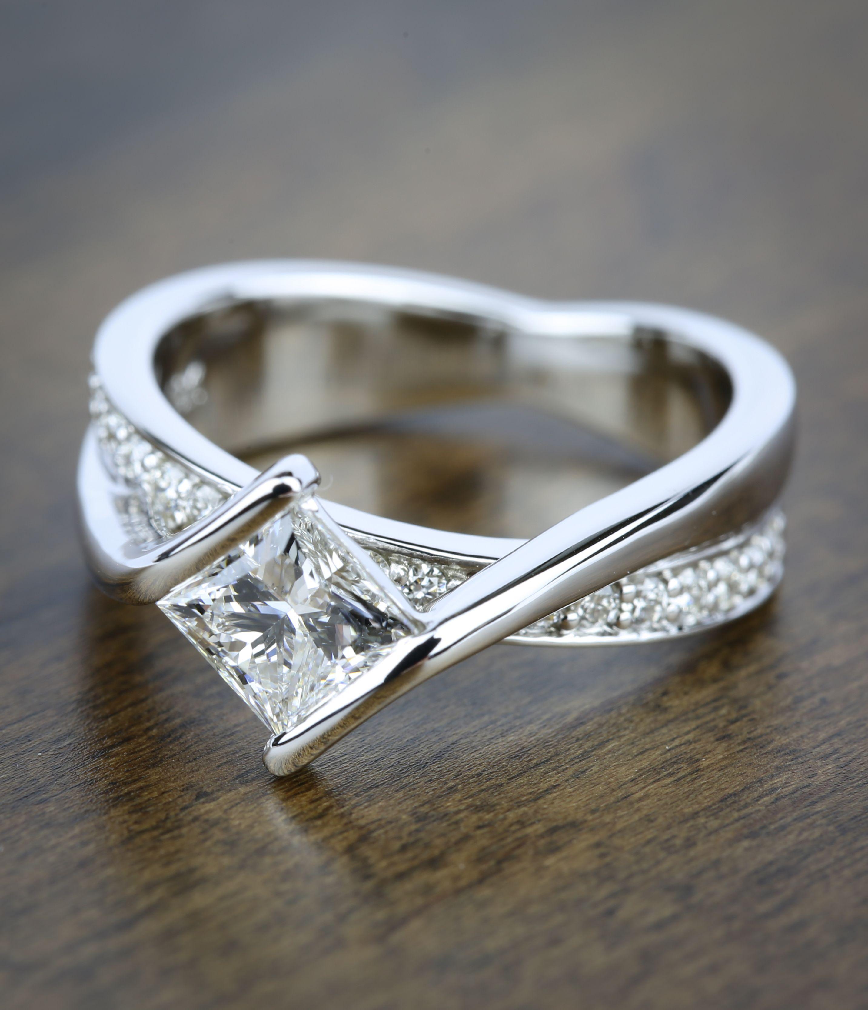 a beautiful bezel bridge princess cut diamond engagement ring in