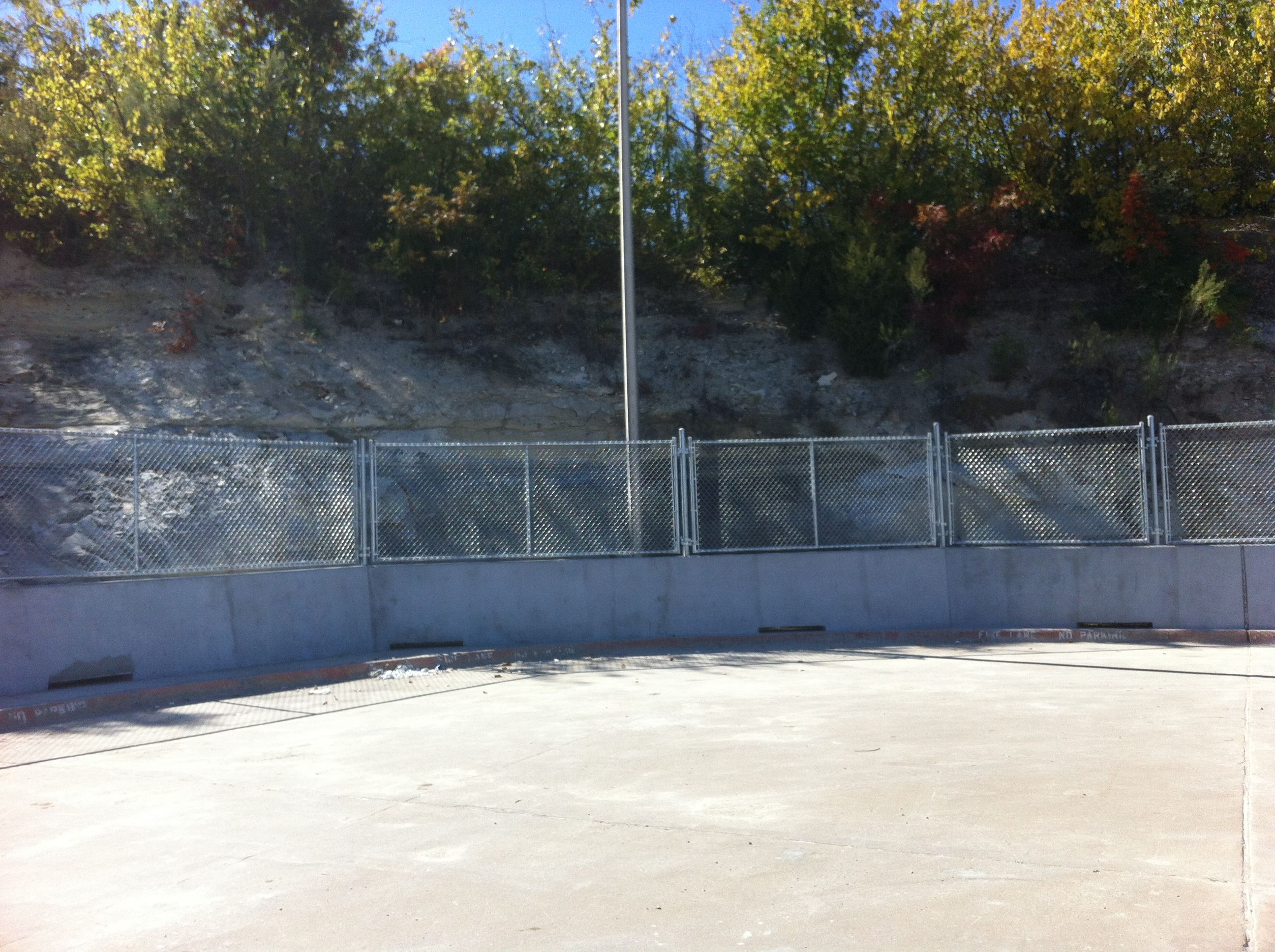 Chain Link Fence On Top Of Concrete Wall Installed By Titan Fence Supply Company Chain Link Fence Fence Contractor Fence