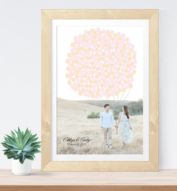 The guestbook is a great way to incorporate your engagement photo into your wedding, this guestbook features your photo with balloons illustrated on top for guests to sign!   See more here: https://www.etsy.com/listing/233202401/photo-guest-book-alternative-for-wedding?ref=shop_home_active_3&ga_search_query=engagement