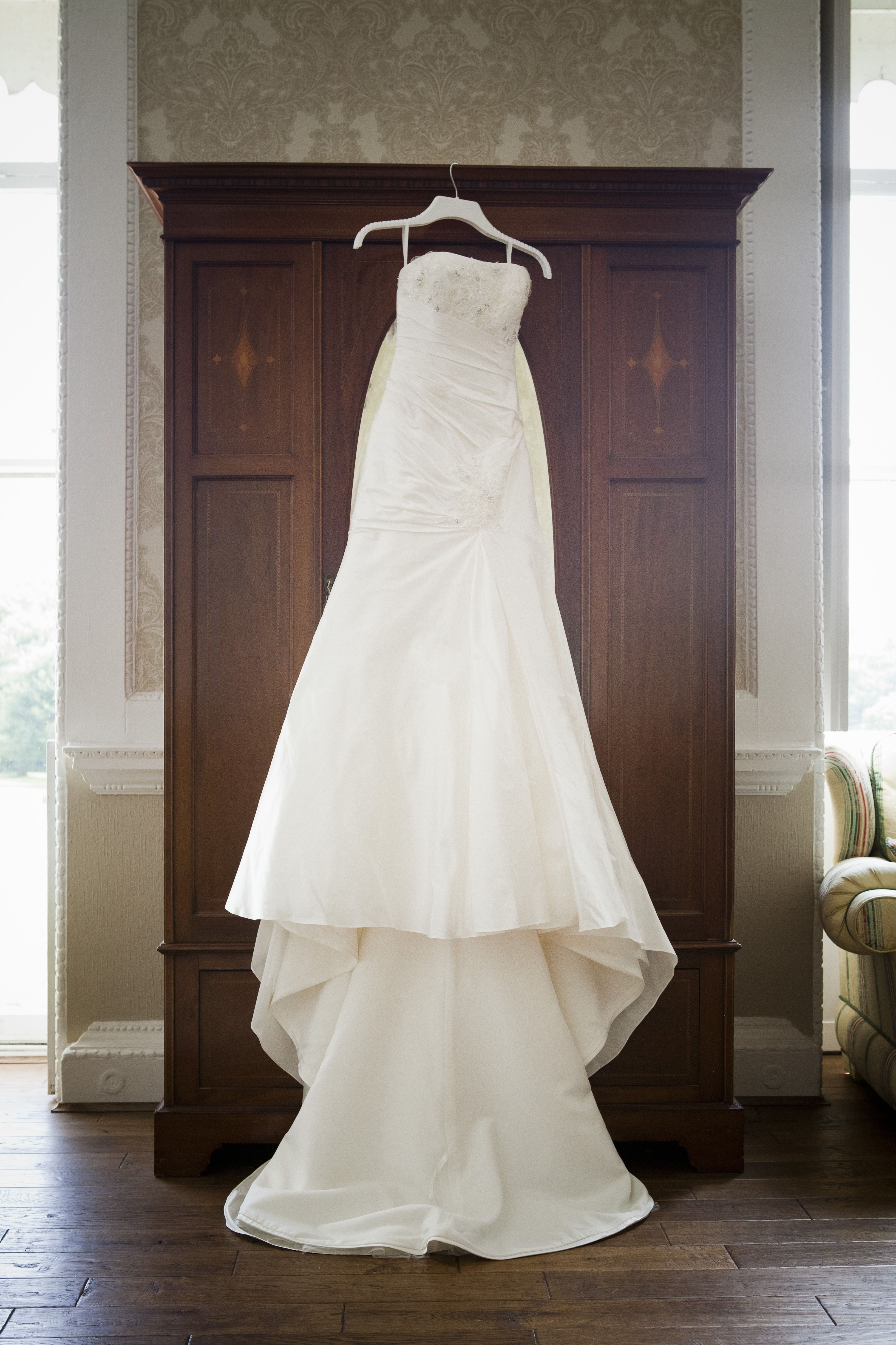 Wedding Dress Hanging Up With Wardrobe