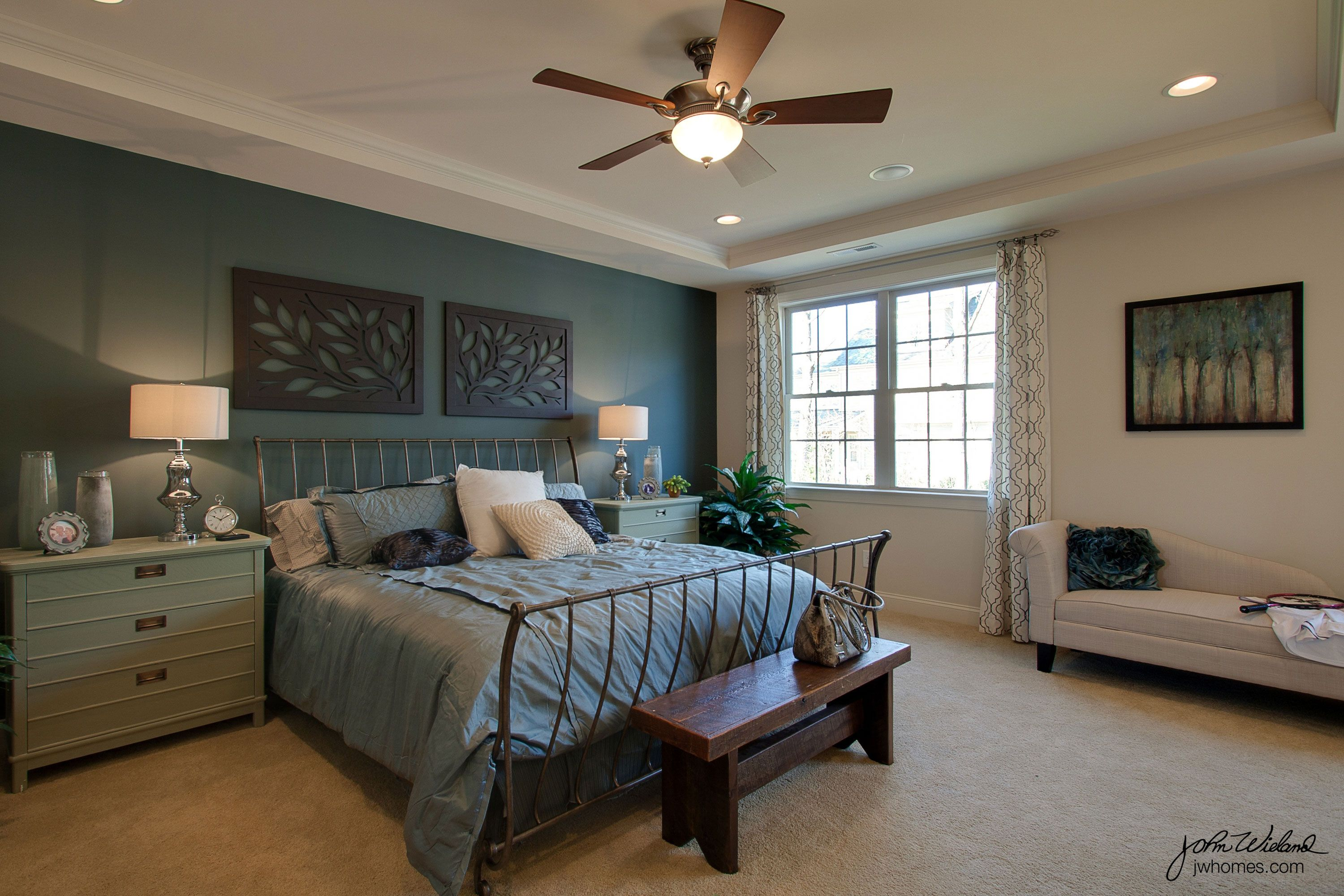 Calming blue bedroom with painted accent wall