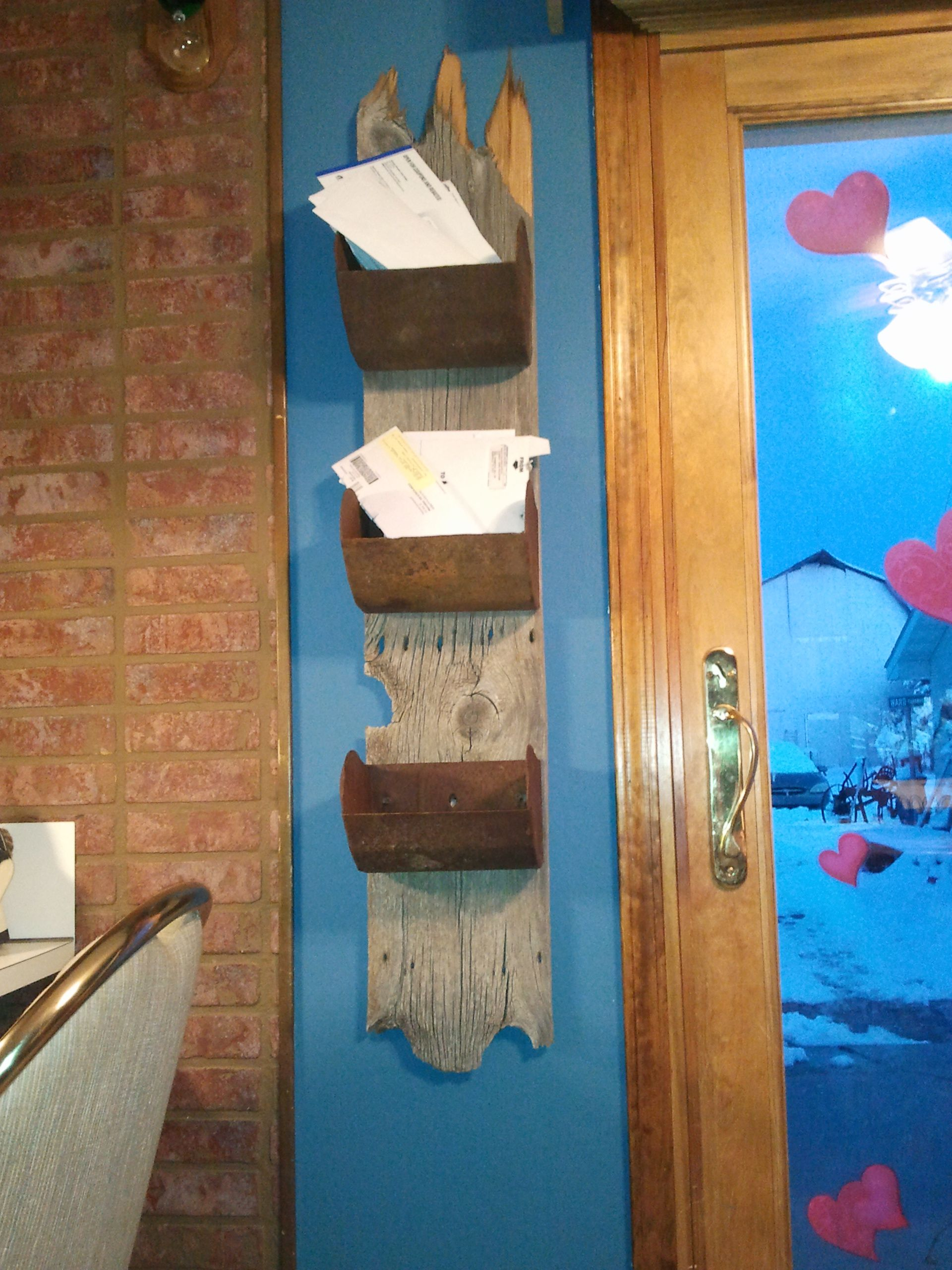 Barnwood + Old grain elevator scoops = our new mail holder ...