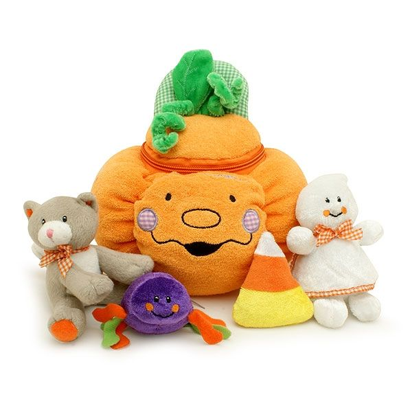 My First Pumpkin Halloween Play Set  Cute Pumpkin Developmental Playset comes with four fun play pieces: Pumpkin carrying case Ghost - squeaker! Cat - meows Spider - rattles Candy Corn - crinkles Pumpkin Size 8 inch wide by 8 inch high Ages Birth and up.