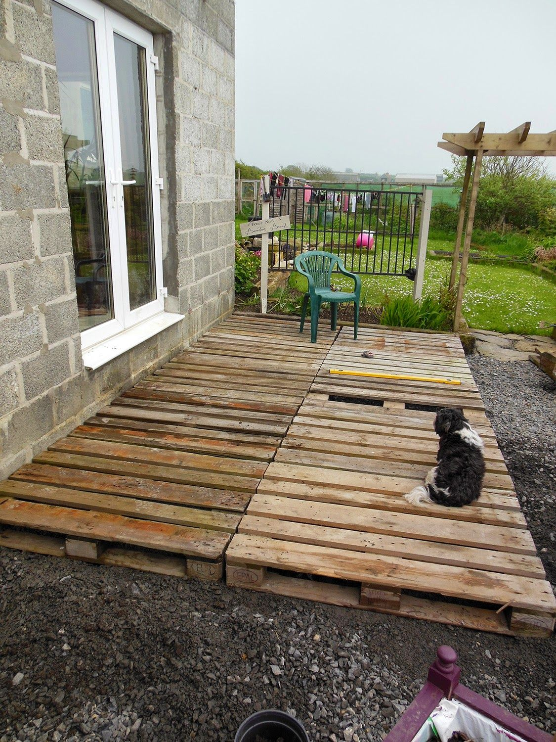 Patio From Pallets Coach House Crafting On A Budget Diy Pallet Wood Decking Ogrd