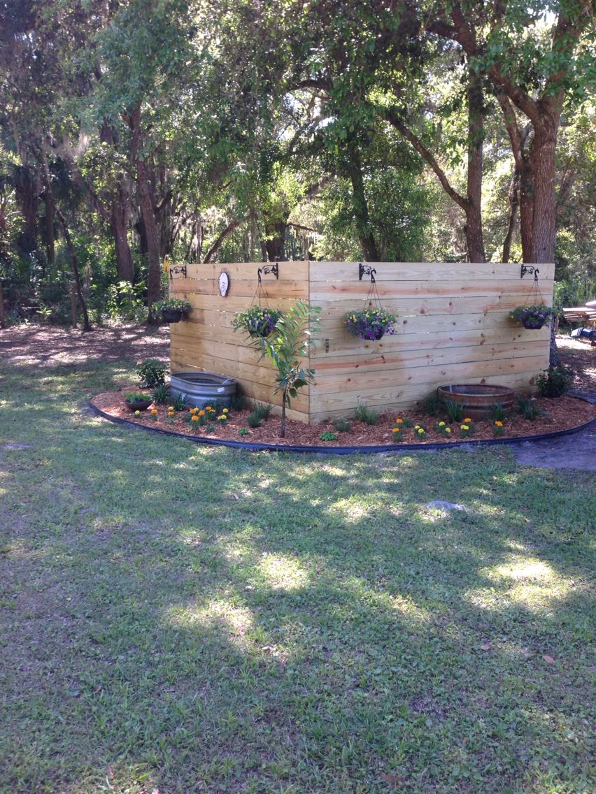 pretty backyard landscaping to hide well pump - Garden Ideas To Hide Septic Tank