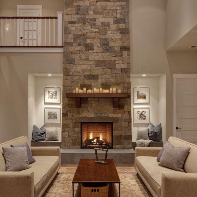 High Ceiling Living Room With Stone Fire Place