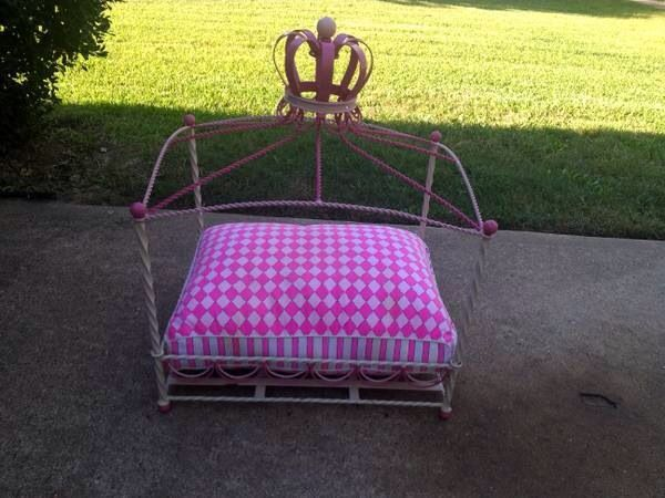 Cute doll bed repurposed and sold for a lot of $$ as s dog bed.