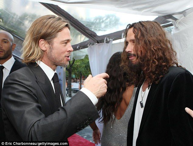 Buddies: Pitt took in the rocker's concerts regularly while Chris hit the actor's film premieres; here they are seen in 2011 at an event for Brad's movie Moneyball