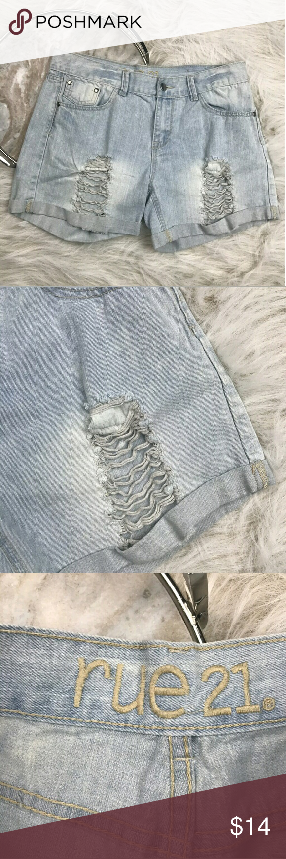 """Rue 21 Mom High Rise Shorts Rue 21 light wash high rise distressed cuffed jean shorts. Womens size 7/8. Gently used, without flaws. See pictures for details.  Waist laying flat - 16"""" Rise - 9"""" Inseam - 4""""  Inventory 04252017 Rue 21 Shorts Jean Shorts"""