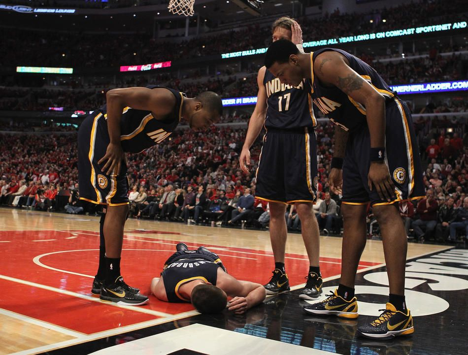 price mike dunleavy and brandon rush of the indiana pacers look down at fallen teammate tyler hansbrough after hit also rh pinterest
