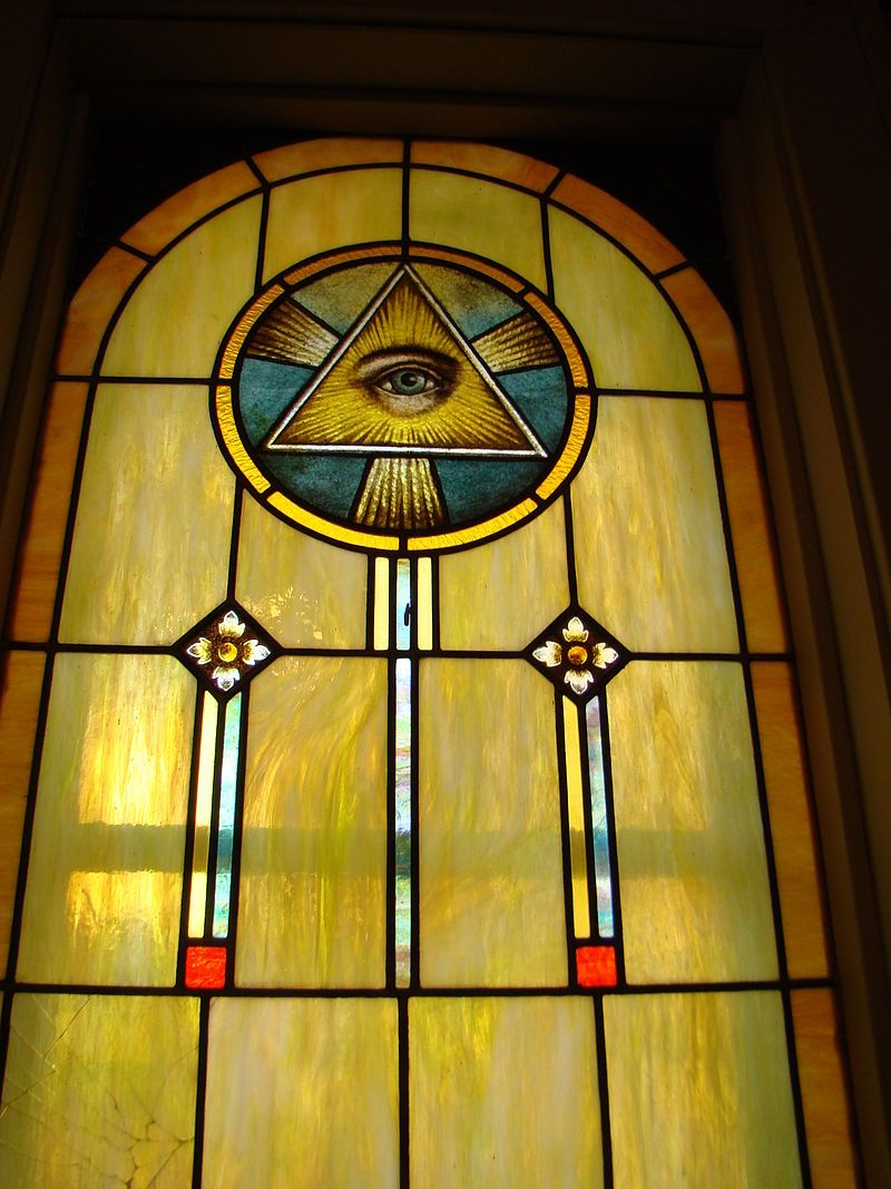 Eye Of Providence Depicted In The Stained Glass Window Of A Church
