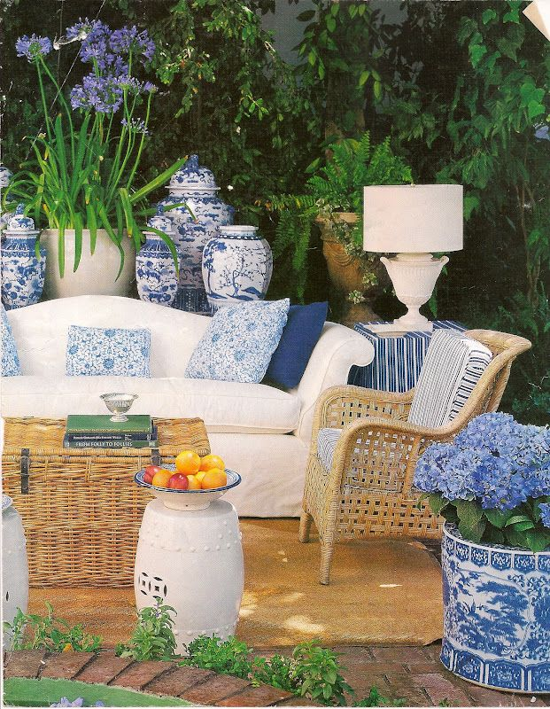 Blue and White porcelain is a great accent on this outdoor seating group.  Wicker ottoman trunks make great coffee tables!