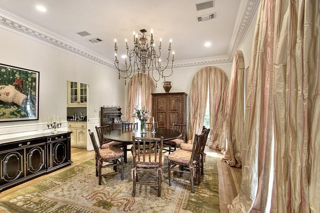 Dining Area With Dramatic Curtains