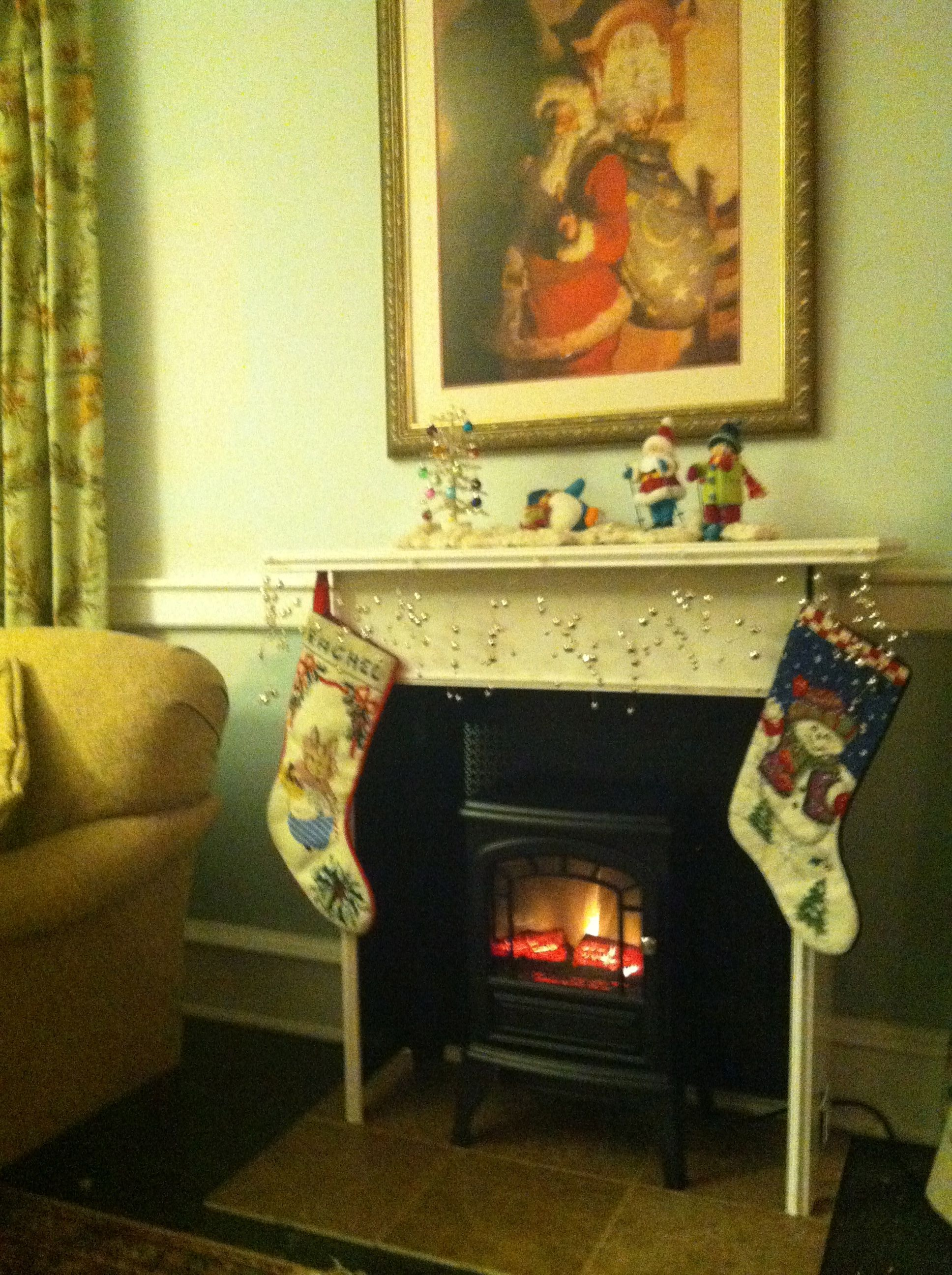 faux fireplace made from an old radiator cover. Six ceramic tiles as ...