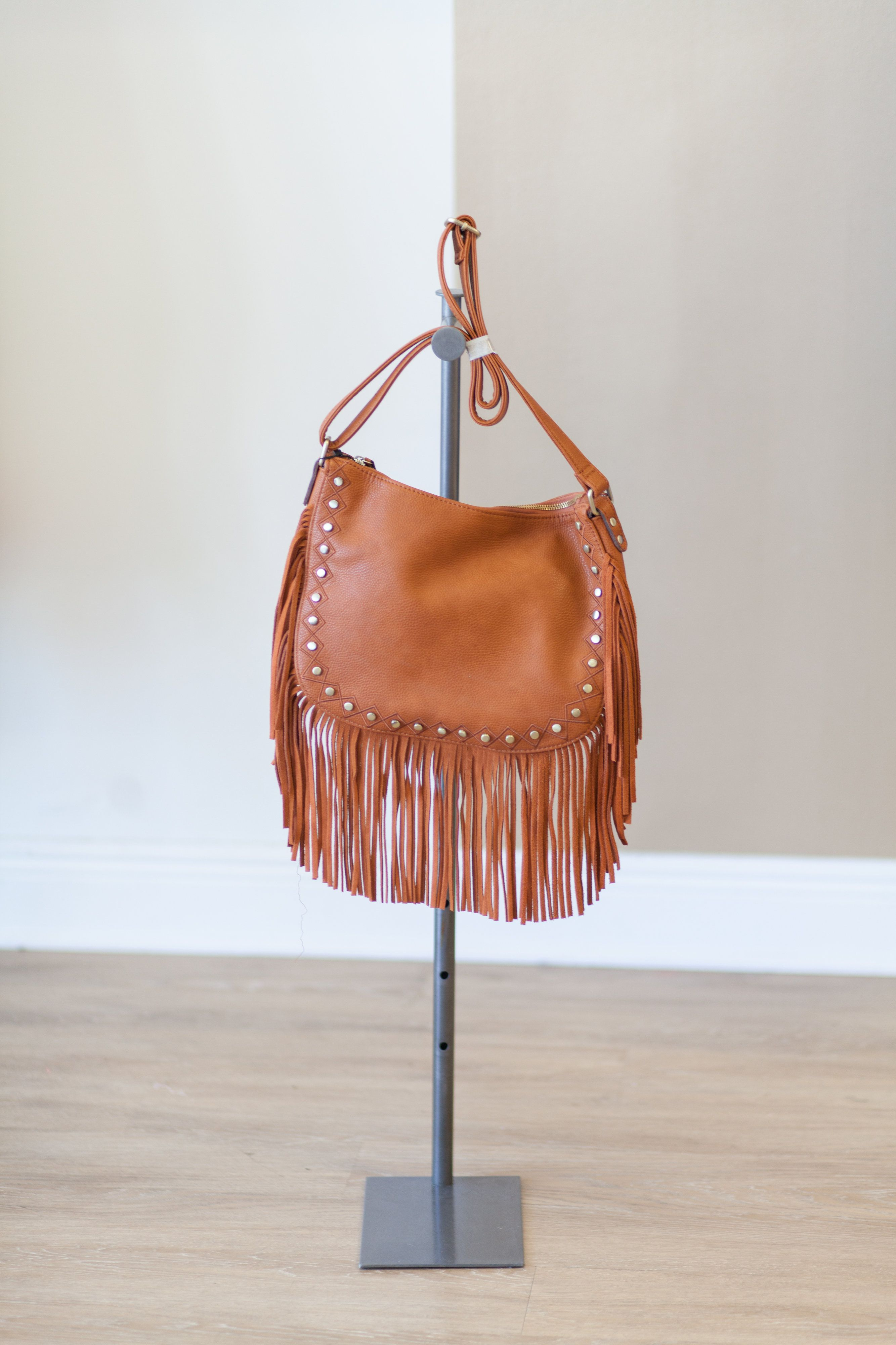 Fringe is  MUST HAVE  this summer!  This fringe bag can be worn on the shoulder or cross body, and the stud detailing is perfection!