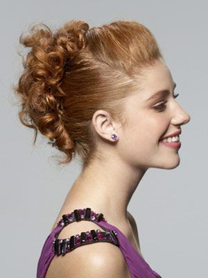To get the look, wash your hair and apply an anti-frizz serum before drying with a diffuser. When hair is dry, split it into three sections and secure each with an elastic. Brush the sides back and put the top elastic forward toward your forehead to create a little volume at the front. Bobby pin the ends of the bottom two ponies over the elastics so your curls cover them. Then pull some strands loose for a softer look and finish with hairspray.