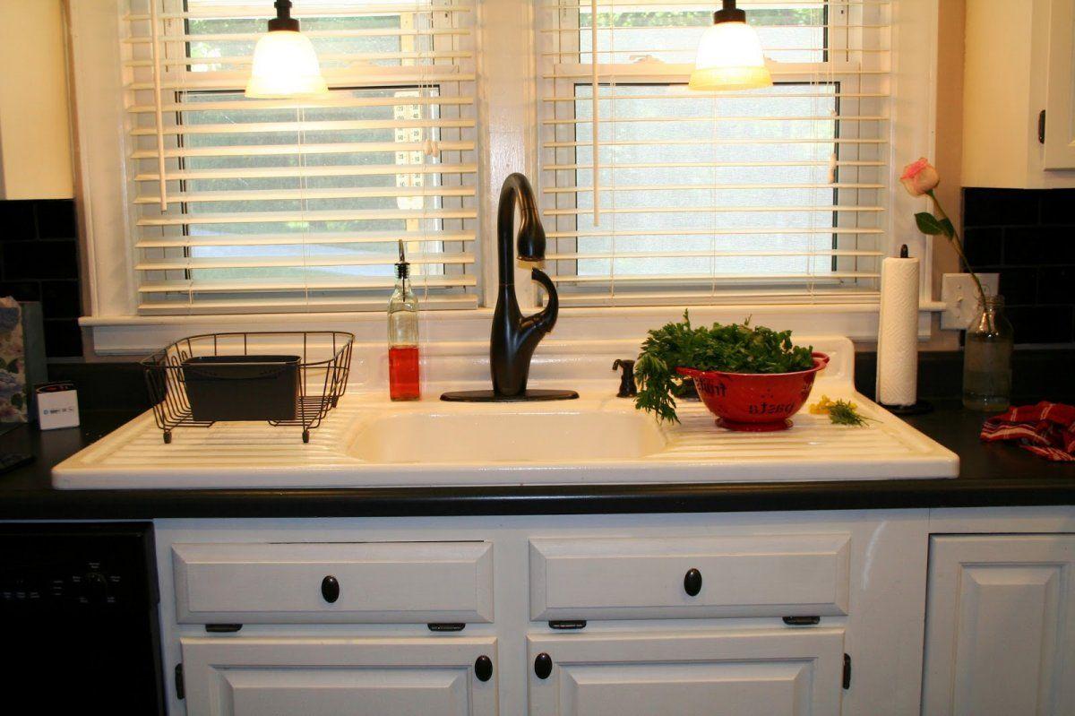 Minimalist farmhouse kitchen sink with artistic black tap on the