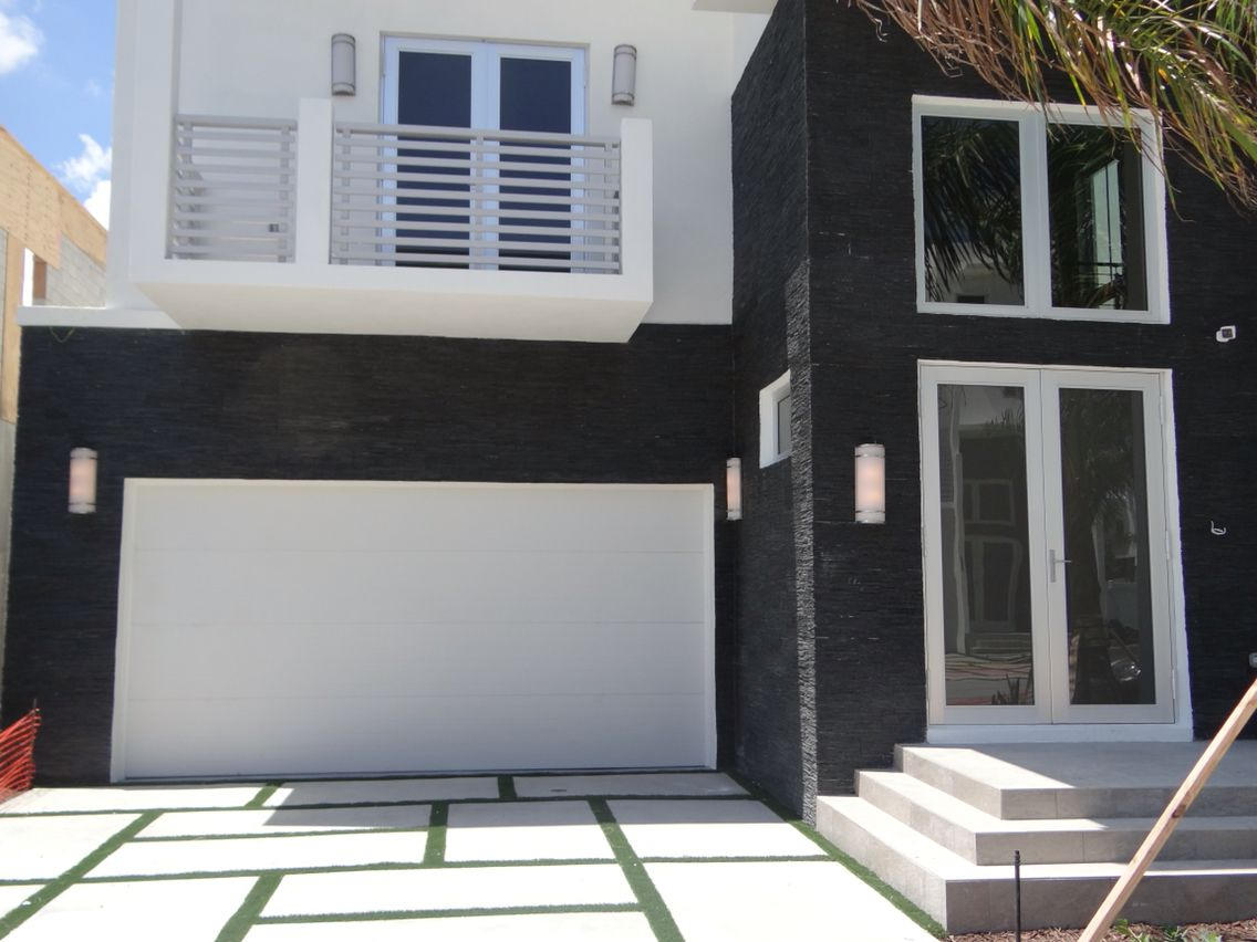 steel by clopay installed adco doors door in home white contemporary pin collection garage florida modern on banko