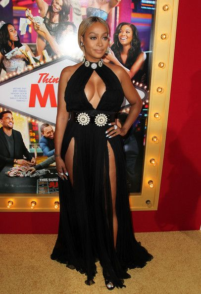 Do you love it? LaLa Anthony bares breasts and thighs in Alexander McQueen